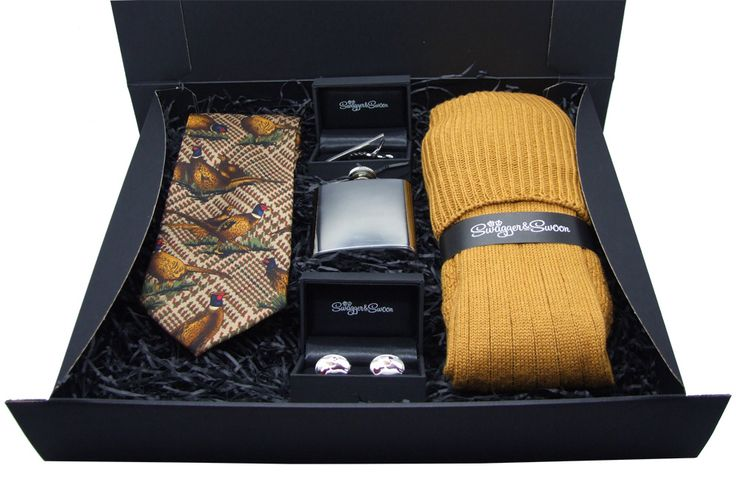 This is our ultimate country themed gift box, containing everything from shooting socks to a pheasant tie, beautifully presented in a stylish black box.