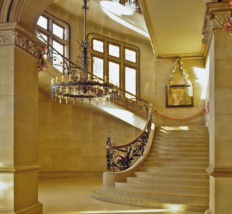 Biltmore House. -- The Cantilevered Staircase. -- Inspired by the staircase at the Chateau de Blois in the Loire Valley, Biltmore's grand staircase is a marvel of physics, built using counterbalance. The weight of each of the solid limestone slab steps is offset by the weight of the wall bearing down on it.