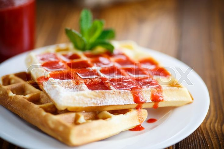 Viennese sweet waffles with strawberry jam on the table. Food Photography. Find more inspirations for your next project on www.colourbox.com