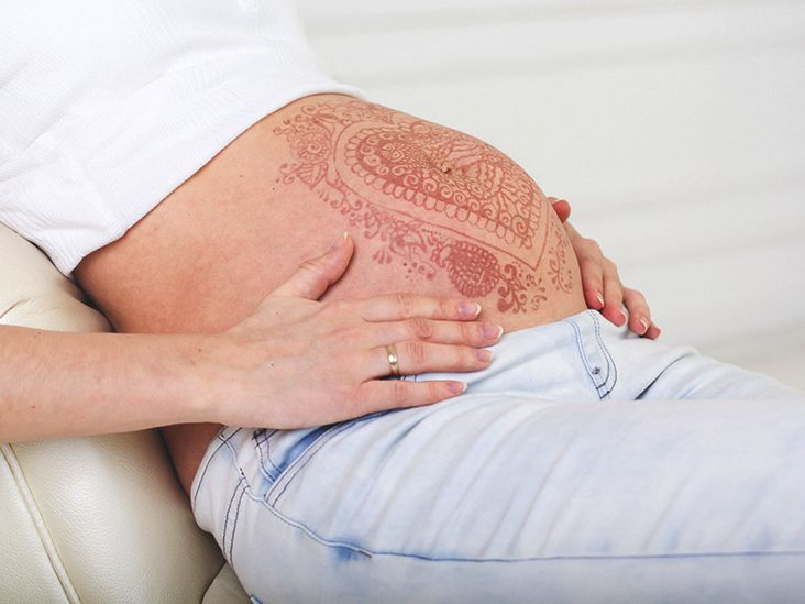 Infection is one of the biggest concerns doctors have with getting a tattoo while pregnant. But what if it's a reputable shop? Then can you? Find out.<br/>