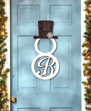 Decorate for the holidays with this Monogram #Snowman Door Hanger. The laser-cut snowman silhouette features a scrolled initial inside the bottom circle and wears a top hat adorned with a glittery snowflake. Hang on the front door using the included twine, or display it as artwork on an interior wall.