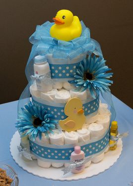 We love the colors of this rubber duck diaper cake, a perfect addition to your duck baby shower theme.