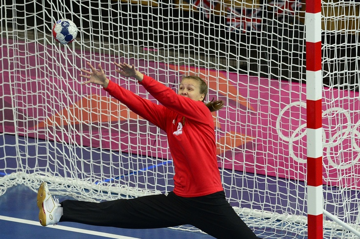 Russia's goalkeeper Anna Sedoykina tries to make a save during the women's preliminaries Group A handball match Great Britain vs Russia for the London 2012 Olympics Games on July 30, 2012 at the Copper Box hall in London.