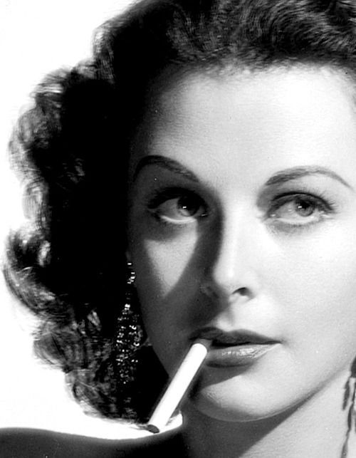 Smoking is bad for your health, but doesn't it look glamorous. Especially when the cig is hanging out of a beautiful mouth like miss Hedy Lamarr's