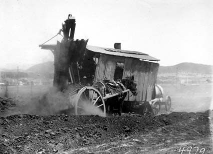 Keystone steam shovel loading a horse drawn dray. Site for the Australian War Memorial