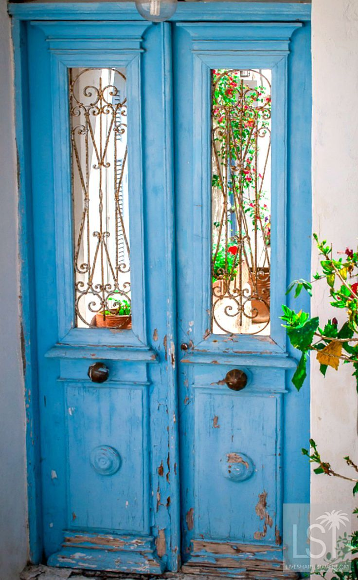 Grecian blue in the doorway of a home on the Greek island of Spetses. Spetses is one of the Saronic Islands, and is easy to travel to - just a short hop by ferry from Athens. The island is car-free, peaceful and the sea off it is a similar colour to this door.
