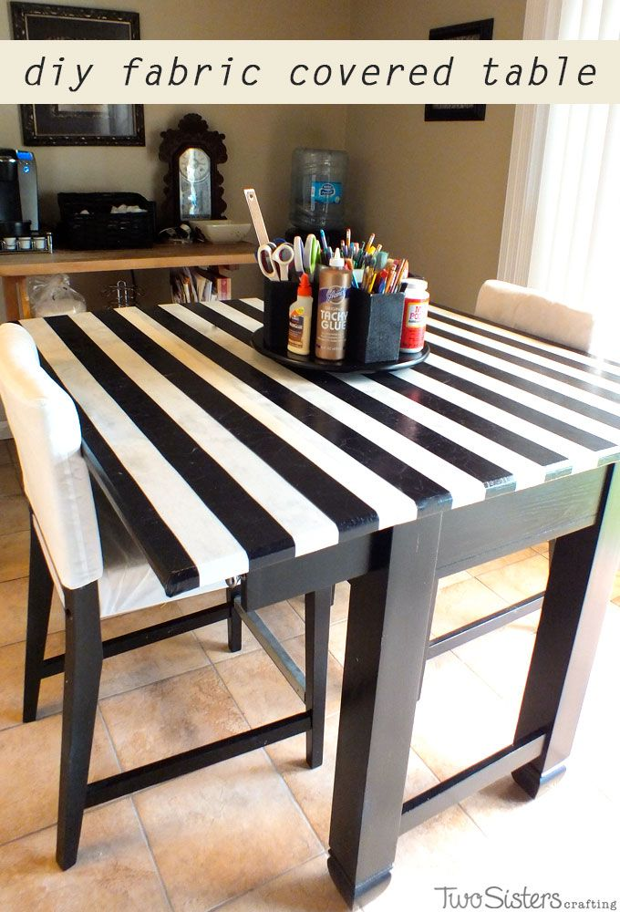 DIY Fabric Covered Crafting Table - made with an old table, fabric and Mod Podge.