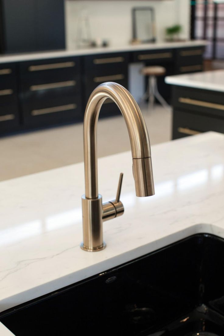 As seen on Fixer Upper, this gold sink fixture gives the kitchen of the Barrett home a modern flair.