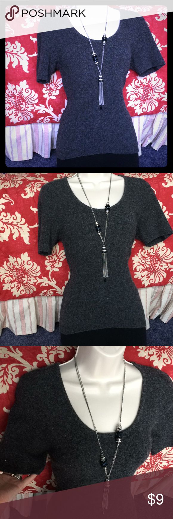 Express short sleeve scoopneck sexy secretary Extremely sexy extremely warm bring out your sexy secretary in this short sleeve charcoal gray mohair figure flattering express sweater. pair with jeans And boots or a high waisted pencil skirt and heels for a great look at work or a date. I have dressed it up with some jewelry can go with any type of jewelry you have! Size xs but it's express stretch. Accepting reasonable offers. Cleaning out my closet saving for the holidays! Bundle to save…