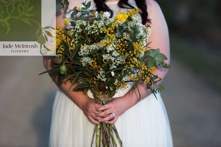 Leanne's oversized bouquet is a textural and visual delight, featuring wattle, nutty gum, geralton wax, flannel flower, billy buttons, paper daisies, eggs and bacon, rice flower, South Australian daisies, dollar gum, grevillia and berzelia berry. www.jademcintoshflowers.com.au www.somethingbluephotography.com.au