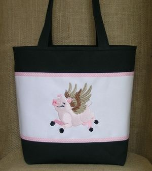 When pigs fly they are happy and so is this embroidered pig on this black and white tote.