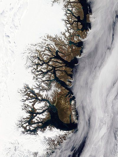 In English usage, a fjord is a narrow inlet of the sea between cliffs or steep slopes, which results from marine inundation of a glaciated valley. Fjords are found in locations where current or past glaciation extended below current sea level. The fractal coastline of eastern Greenland, seen here, has many fjords. At the bottom is the longest fjord in the world, Scoresby Sund.