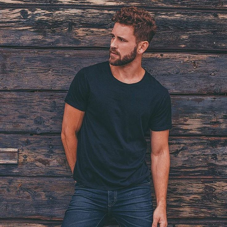 "Nick Viall -  Nick Viall in a black T-shirt and jeans looking pretty vascular.  The Bachelor star'shilarious caption: ""Discreetly getting that wedgie #madeinfidelity. @abe.bermudez."""