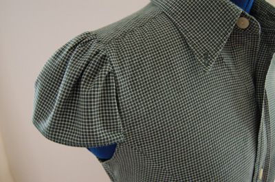 'Man's shirt reconstructed for a woman'. Plus link to tutorial for reshaping man's shirt to cap sleeve blouse.