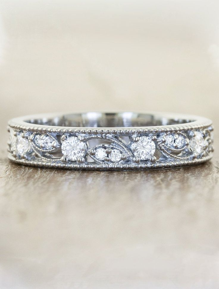 Vintage-inspired wedding band featuring 0.36ct diamonds set within the band. by Ken & Dana Design.