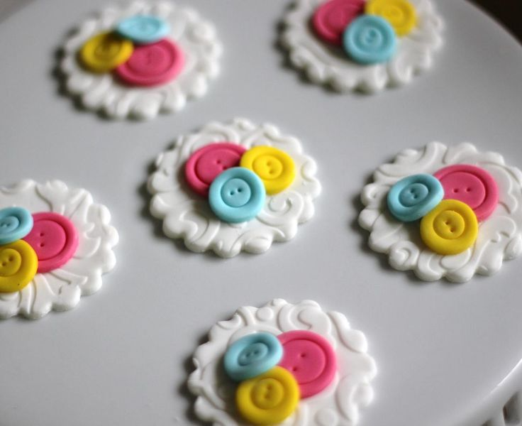 Cute fondant button cupcake toppers.  Available at https://www.etsy.com/shop/LesPopSweets?ref=hdr_shop_menu