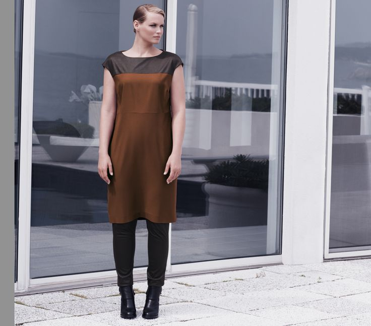 Fluid crêpe dress worn with faux washed-leather trousers and high heel ankle boot in calfskin.