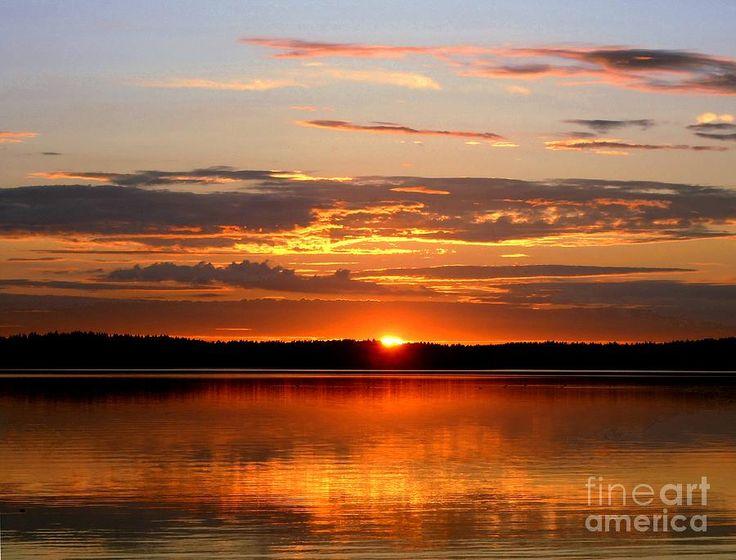 'Midnight Sun' - Photograph by Alan Hogan. A tranquil sunset photo taken near the town of Uusikaupunki in Finland. #finland #photography #visitfinland #sunset #midnightsun #lake #lakeside #eu #europe #scandinavia #nordic #landscape #seascape #weareinfinland #clouds #nature #natural #scenery #scenes #finnish #sky #sea