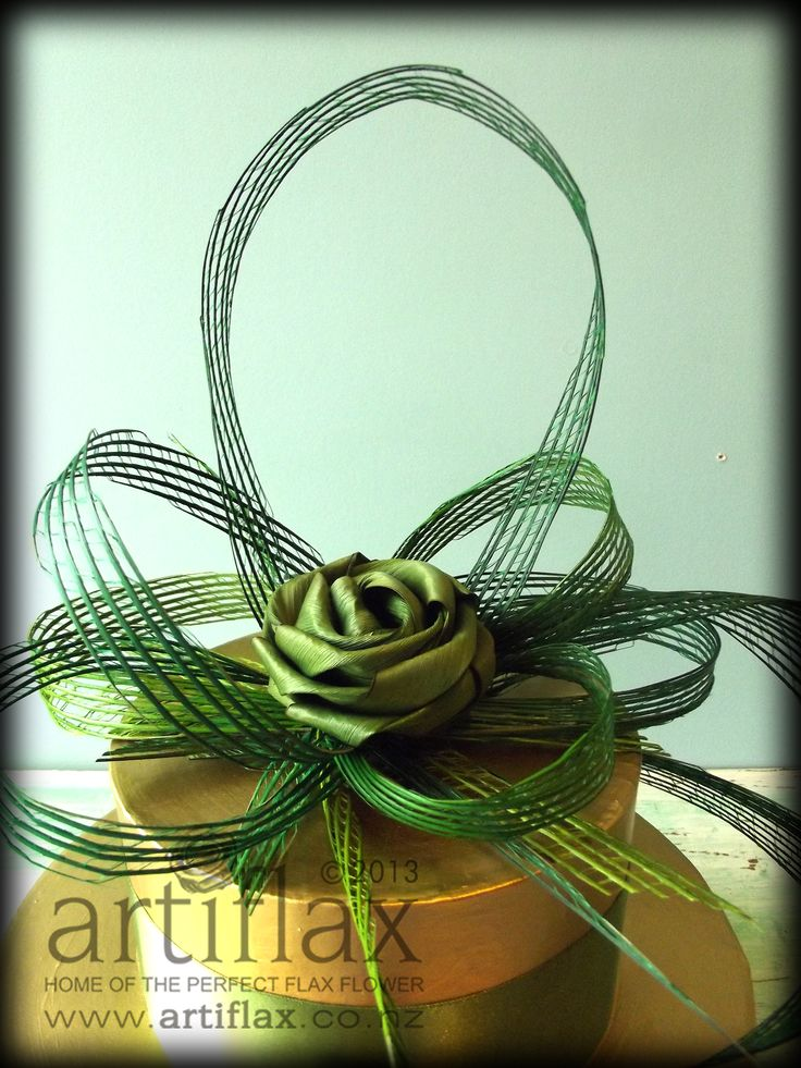 Flax flower cake spray in shades of green