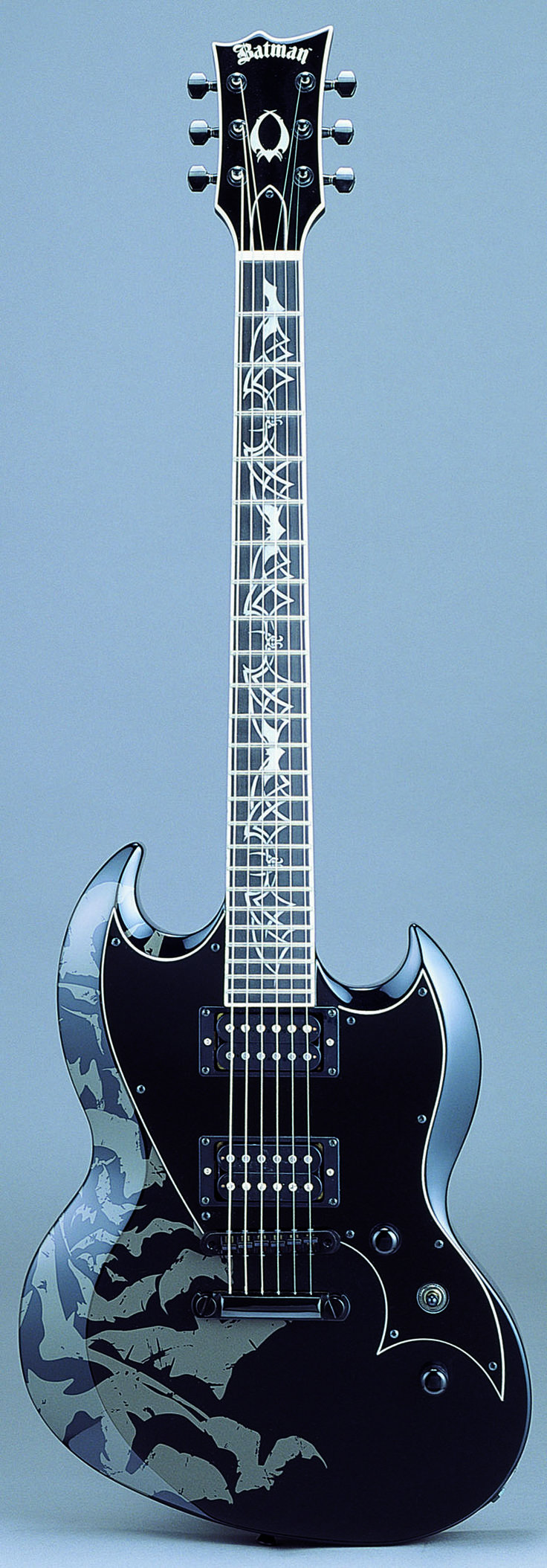 Japanese-made ESP Viper 'Batman' edition http://www.espguitars.co.jp/batman/ - those inlays drive me insane?