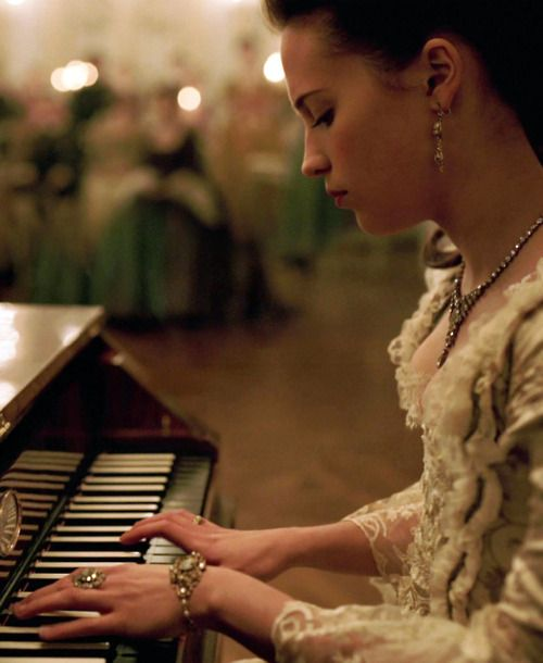 """Isn't the music beautiful?""     She smiled softly as her fingers danced across the keys. ""The piano was always my favorite. It was my escape. Whenever I played, I could disappear into another world. This world."""