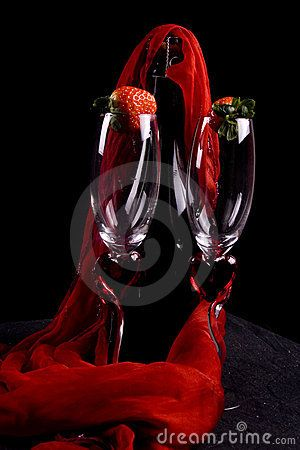 Two champagne flutes and strawberries.