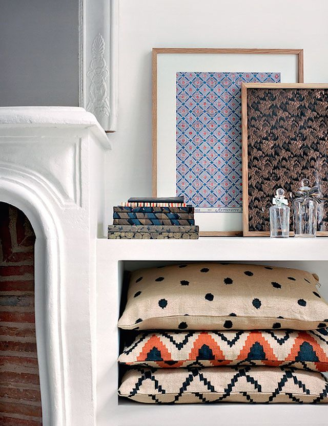 At home with Sézane | French By Design Floor cushions on shelf