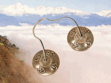 Tinghsas are also for clearing space of negative energies and the healing and balancing of auric fields.  Strike one cymbal against the other on their edges at right angles. Let the bell ring until there is silence.
