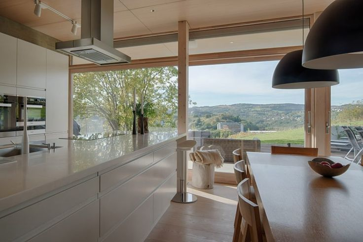 This floor-to-ceiling glass contains sliding doors, which connect the internal spaces with a covered terrace that stretches the full width of the house.