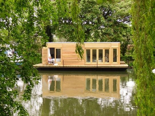 "interesting:  - would have more windows though. The Eco Floating Home's ethos is ""to construct healthy, ethical homes that enhance the countryside and deliver maximum comfort with minimum energy bills and a small carbon footprint."" These homes utilize energy efficiently by harnessing natural light, incorporate solar heating, photo galvanic cladding, waste and water treatment, and passive energy control systems like green roofs."