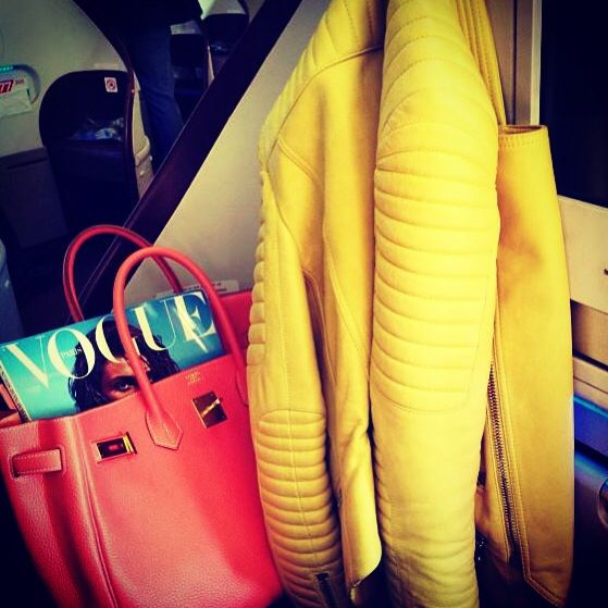 #Balmain yellow jacket ,red #Hermes bag and #Vogue magazine! Travelling in style