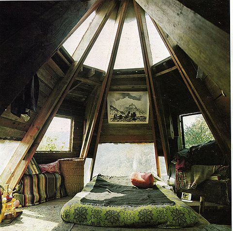 Some sort of pyramidal wooden tee pee bedroom