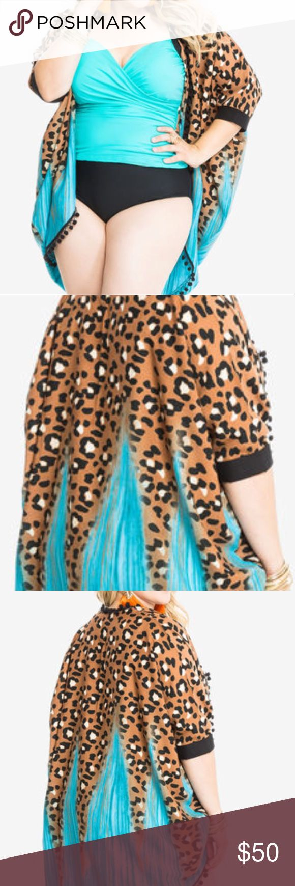 """Cover up and swim top 14/16 Soak up the sun in my cheetah print plus size bandeau top! Pair with my Cheetah Print Ruched Swim Skirt for a matching set.Soft, lightly padded lining. Adjustable straps. Back clasp closure.Plus size 14 measures 15.5"""".  Cover up included... torrid Swim Coverups"""