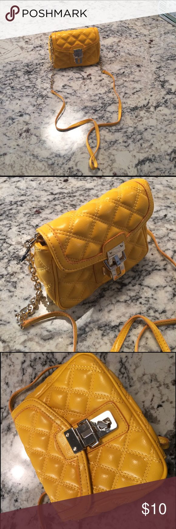 Banana Republic yellow purse Banana Republic quilted faux leather yellow shoulder bag. Small. Strap can sit inside and makes a nice clutch. Never used. Banana Republic Bags