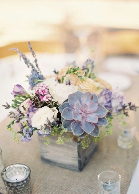 Succulent wedding centrepieces