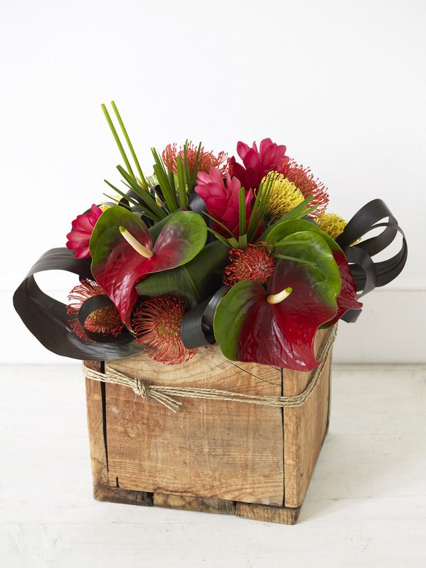 Exotic Flowers Arranged in Wooden Box