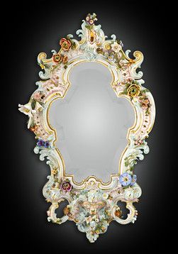 Antique Mirrors, Antique Meissen, Antique Porcelain ~ This fabulous Meissen porcelain mirror is a work of incomparable skill and artistry.Lifelike flowers, graceful curves, and an arabesque shape make this mirror a Rococo masterpiece with three extending candleholders, this mirror can illuminate an entire room Circa 1890