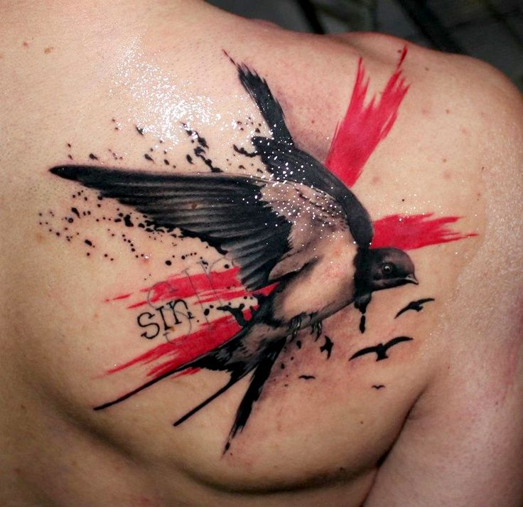 swallow Tattoo  on the back. For more stunning and wonderful tattoo ideas and design, visit www.tattooenigma.com