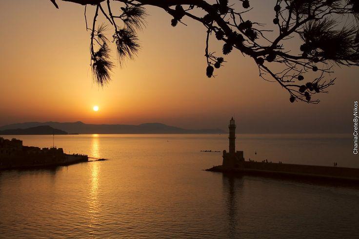 Sunset, lighthouse, old harbor, Chania, Crete, Greece
