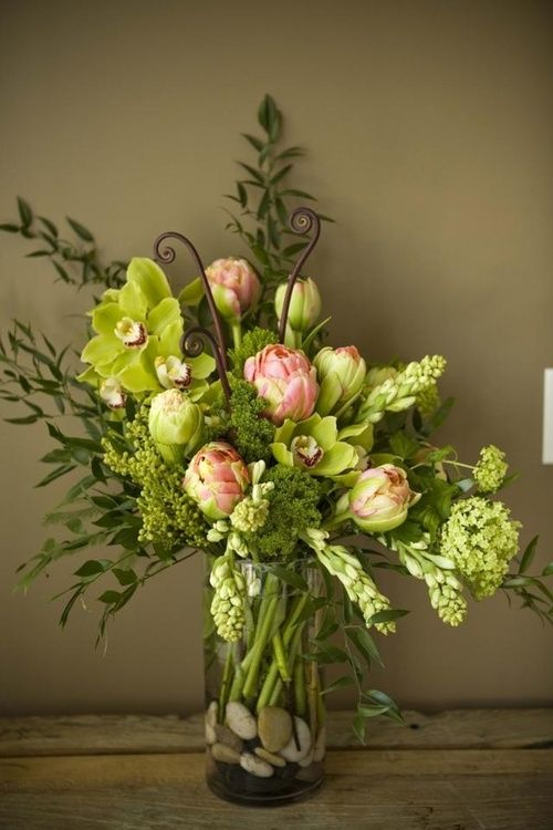 .green and pink spring arrangement fern fronds tulips cymbidium orchids Italian ruscus tuber rose