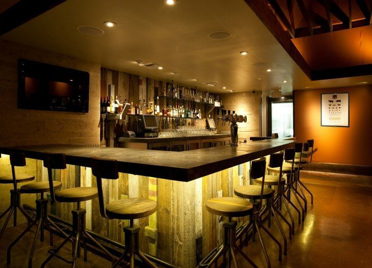 Reclaimed wood bar. Love the patina of the wood and the lighting in this space.