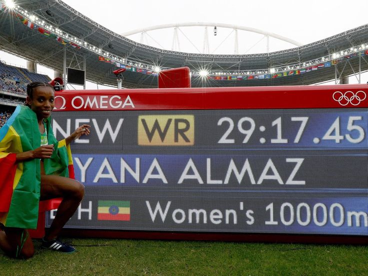 · Aug 12    Almaz Ayana of Team ETH celebrates winning the Women's 10000 Meters Final and setting a New World Record of 29:17.45