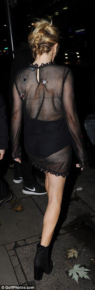 Ellie Goulding flashes her assets in sheer and mini dress