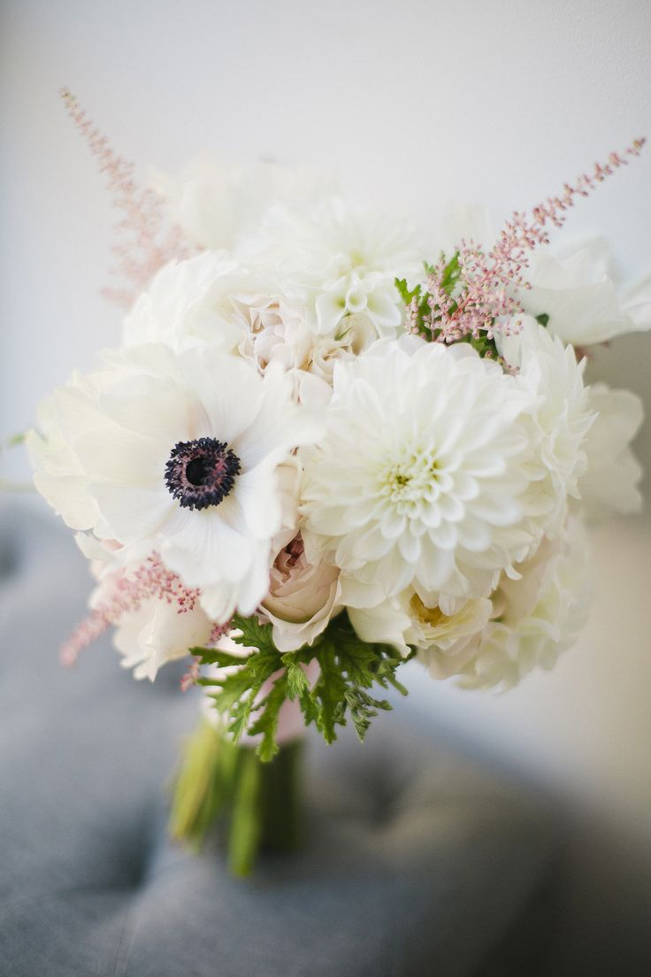 All-white modern #bouquet | Photography: Chung & Bo Of CLY CREATION - www.clycreation.com Read More: http://www.stylemepretty.com/tri-state-weddings/2014/05/01/modern-fall-brooklyn-wedding/