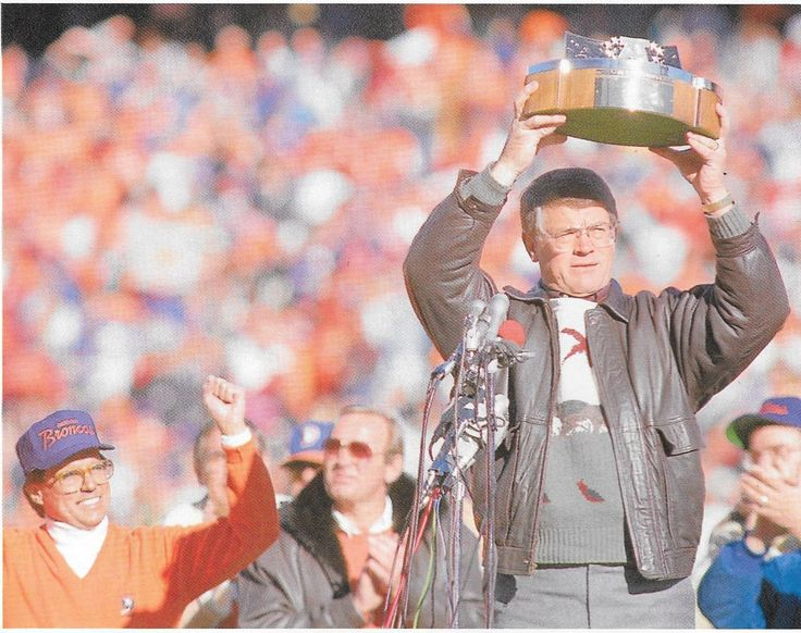 Coach DAN REEVES hoisting the AFC Championship trophy--January 1987