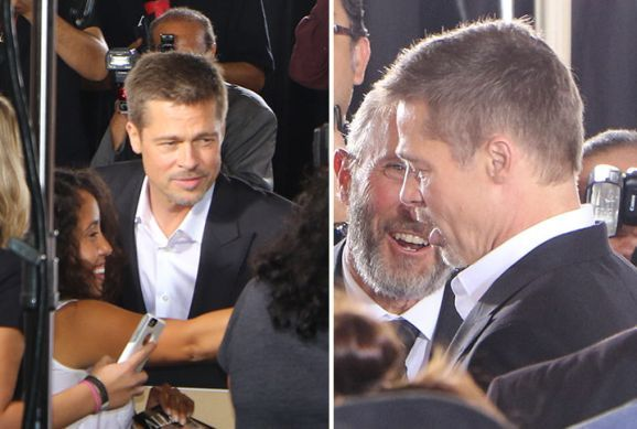 Brad Pitt takes photos with fans as steps out for movie promo