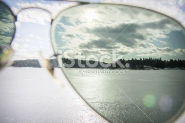sunglasses displays in front of half the picture Royalty Free Stock Photo