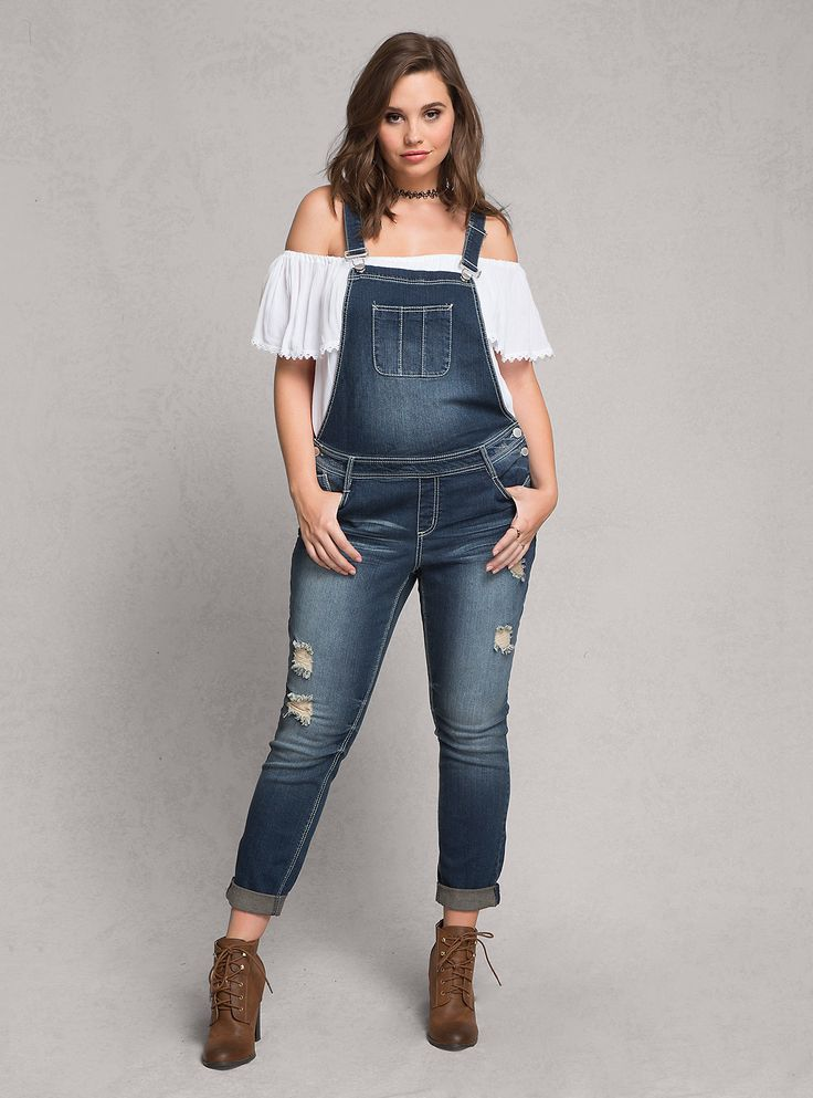 The farmer-chic overalls style is back with a vengeance. Only this time it's wayyy better than the styles you had in the 90's, with a sleek dark wash, white contrast stitching, and ripped destruction. Plus Size