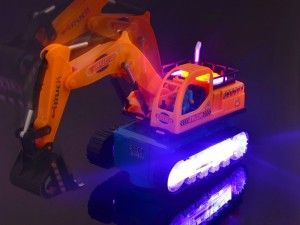 WolVol Electric Excavator Construction Truck Toy with Beautiful Flashing Lights and Music, goes around and changes directions on contact (Battery Powered) - Great Gift Toys for Kids