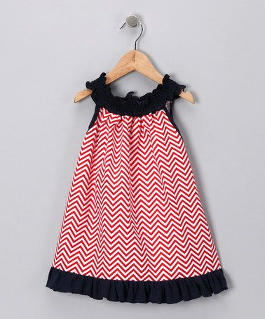 Take a look at this Navy Red Chevron Smocked Tunic - Toddler